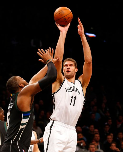 Brooklyn Nets center Brook Lopez(11) shots over Milwaukee Bucks forward Greg Monroe (15). Photo by Jim McIsaac/newsday.