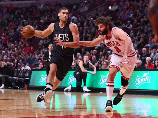 Brooklyn Nets center Brook Lopez dribbles past Chicago Bulls center Robin Lopez. Photo Courtesy of Mike DiNovo-USA TODAY Sports.