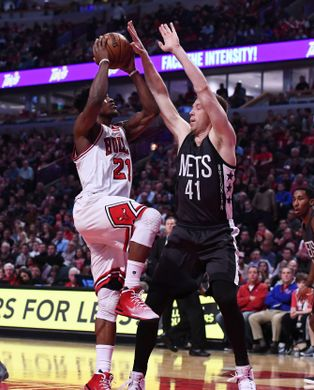 Chicago Bulls forward Jimmy Butler shoots over Brooklyn Nets center Justin Hamilton. Photo Courtesy of  Mike DiNovo-USA TODAY Sports.