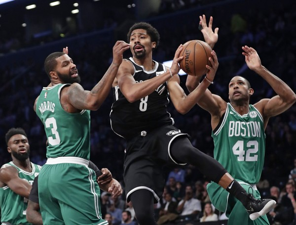 Brooklyn Nets' Spencer Dinwiddie (8) makes a pass while Boston Celtics Al Horford (42) and Marcus Morris (13) defend him. Photo: AP Photo/Frank Franklin II)