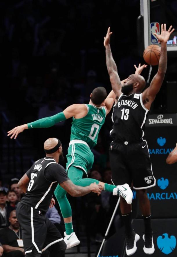 Boston Celtics' Jayson Tatum (0) goes for a layup against Brooklyn Nets' Quincy Acy (13). Photo: AP Photo/Frank Franklin II