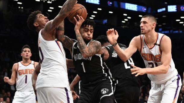 Nets guard D'Angelo Russell (1) grabs a rebound. Photo:Kathleen Malone-Van Dyke