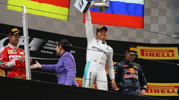 Rosberg celebrates his sixth consecutive win on the podium. (Image credit: Sky Sports F1)