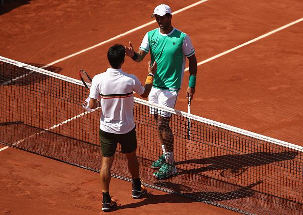 Nishikori and Verdasco shake hands at the net (Photo by Julian Finney / Getty)