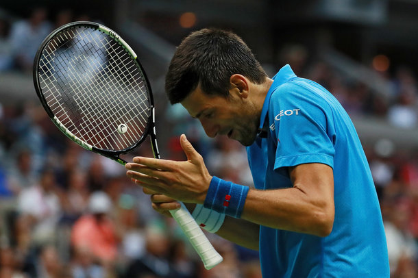 Djokovic reacts to a point (Photo by Michael Reaves/Getty Images)