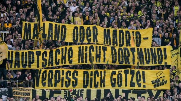 'Milan or Madrid - Just not Dortmund' The yellow wall make their feelings clear. | Source: Noz