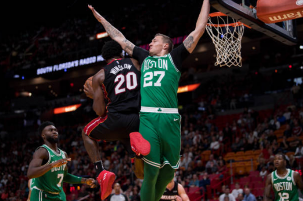 Justise Winslow  of the Miami Heat drives past Daniel Theis of the Boston Celtics during the game at the American Airlines Arena on October 28, 2017 in Miami, Florida. Photo by Rob Foldy/Getty Images