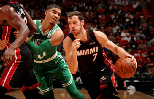 Goran Dragic handles the ball during the game against the Boston Celtics. Photo by Issac Baldizon/NBAE via Getty Images