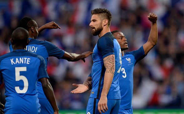 Giroud (pictured, no.9) celebrates one of his two goals against Scotland - he has divided national opinion over his selection. | Photo: Getty