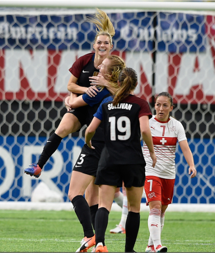Kealia Ohai (#7) is congratulated by Samantha Mewis (#3) and Andi Sullivan (#19) after scoring her first international goal. | Photo: Hannah Foslien - Getty Images