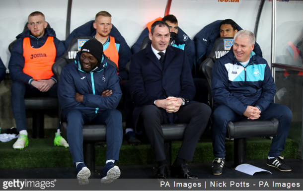 The Swansea City manager, Paul Clement (centre) with his assistence Giggs (right) on the bench during the Premier League match, at the Liberty Stadium. Swansea