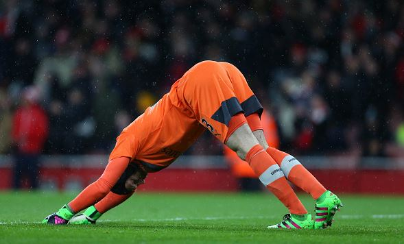 Cech (pictured here) stretching his injured calf in the final few minutes v Swansea | Photo: Getty