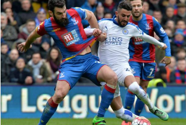 Jedinak battles for the ball with Mahrez as Cabaye watches on | Photo: Getty images