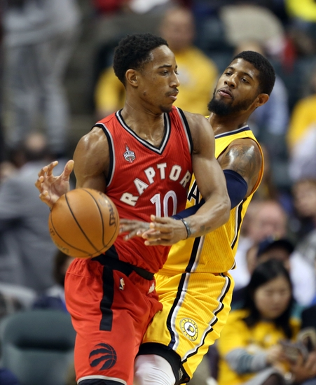 Raptors guard Demar DeRozan (10) is guarded by Pacers forward Paul George (13) Credit:Brian Spurlock- USA TODAY Sports
