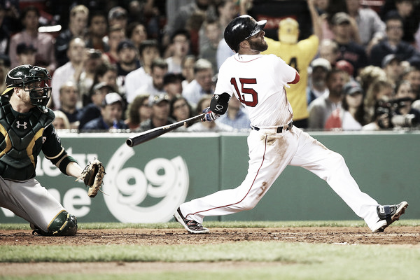 Dustin Pedroia hits a home run in the third inning. Photo: Adam Glanzman/Getty Images North America