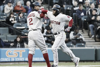 Xander Bogaerts (left) and Dustin Pedroia (right) celebrate after Pedroia's home run in the first inning. Photo: Kamil Krzaczynski-USA TODAY Sports