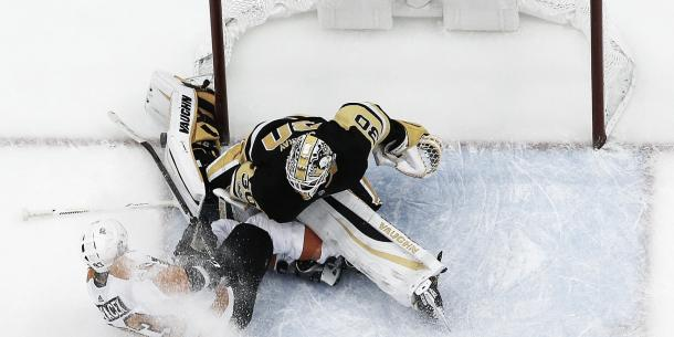 Jakub Vorcek tries to force one in against the Pen's Matt Murray. (Photo credit: USA Today)