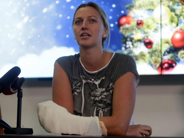 Kvitova speaking to the media, with her left hand wrapped in a cast, in her first public appearance since the attack. Photo credit: Reuters.