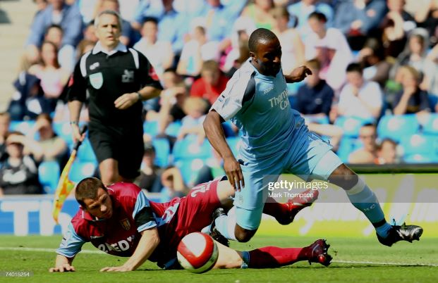 MANCHESTER, UNITED KINGDOM - APRIL 28: Darius Vassell of Manchester City battles for the ball with Phil Bardsley of Aston Villa during the Barclays Premiership match between Manchester City and Aston Villa at The City of Manchester Stadium on April 28, 2007 in Manchester, England. (Photo by Mark Thompson/Getty Images)
