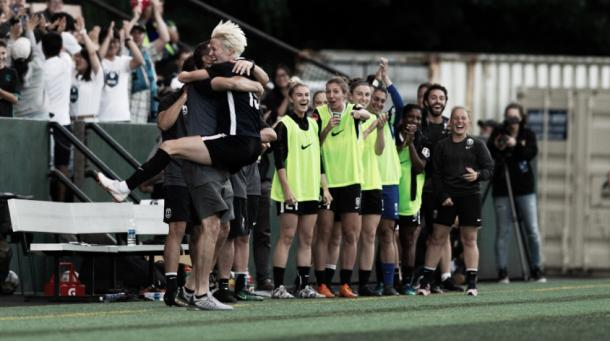 Megan Rapinoe of the Seattle Reign celebrates a goal against the Utah Royals on July 11, 2018   Photo: NWSLsoccer.com
