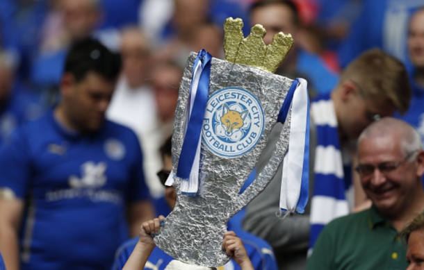 A Leicester supporter lifts a homemade Premier League trophy aloft at Wembley ahead of their Community Shield clash. | Photo: Getty