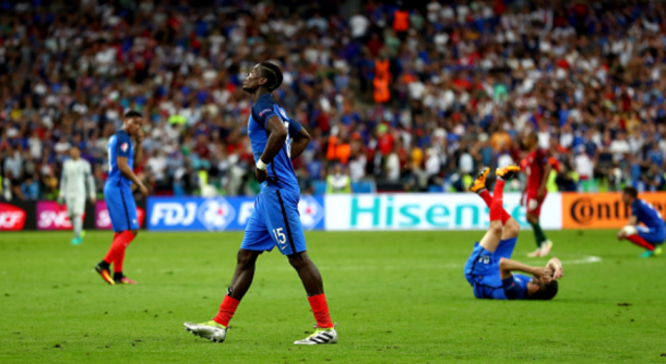 Pogba (centre) is set to become the world's first £100m player, a month after falling short in the Euro final with France. | Photo: Getty