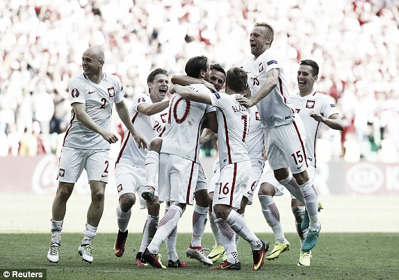 Above: Poland celebrating their penalty shootout victory over Switzerland | Photo: Reuters