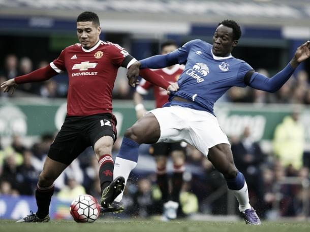 Chris Smalling and Romelu Lukaku battle for the ball when the sides last met in October. | Photo: Getty Images