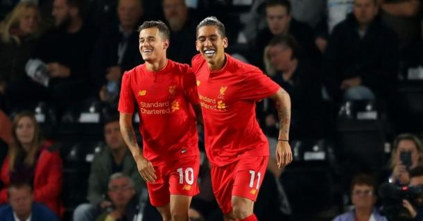 The Brazilian duo celebrate after Philippe Coutinho scores (Photo: Google)