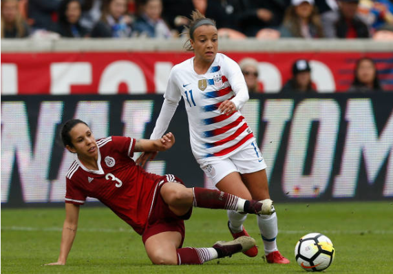 Mallory Pugh (right) is defended by Bianca Sierra in the Aoril 8th meeting between USA and Mexico. | Photo: Tim Warner - Getty Images
