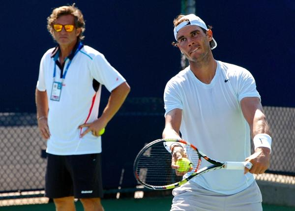Rafael Nadal serves at practice under the watchful eye of assistant coach Francisco Roig at the 2015 Western & Southern Open in Cincinnati/Rafa Nadal Fans