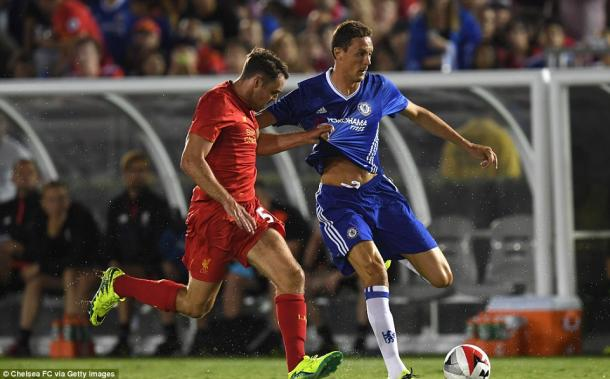 Randall battles for possession during a competitive friendly match (photo; Getty Images)