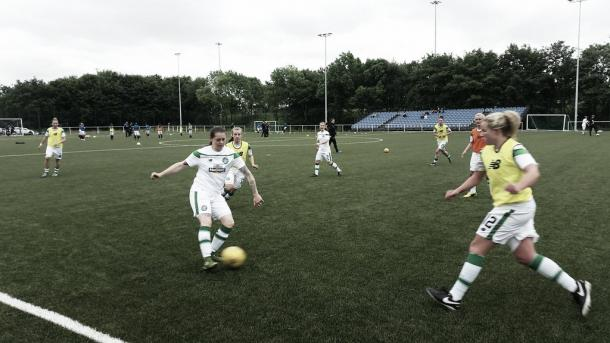 The Celtic and Rangers teams warming up. Photo: Twitter @CelticFCWomen