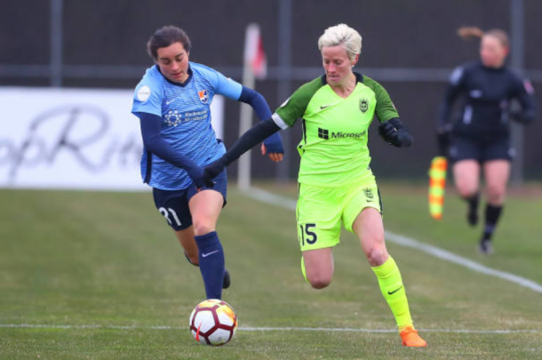 Megan Rapinoe (15) battles with Christina Gibbons (31) before the rain started falling in the 1-0 Seattle victory on April 15. | Photo: Rich Graessle - Icon Sportswire via Getty Images