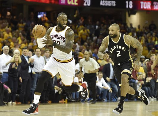Cleveland Cavaliers forward LeBron James (23) steals the ball from Toronto Raptors forward P.J. Tucker (2). Photo by:David Richard-USA TODAY Sports