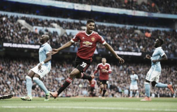 Marcus Rashford celebrates after becoming the youngest player in Premier League history to score in a Manchester derby. | Photo: Getty Images