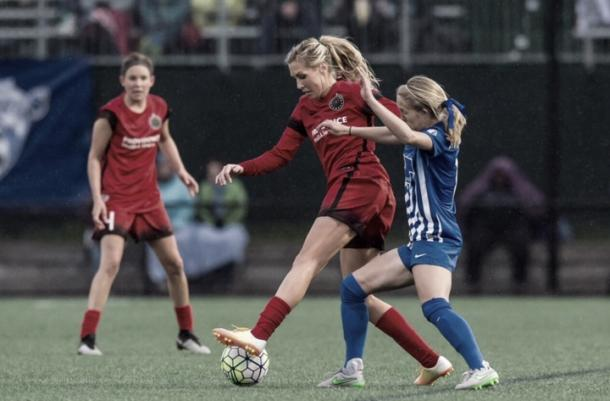 Ratcliffe (right) as she competes for Allie Long (center) for the ball in a season match. Source: Excelle Sports  Jump   Mark as read (esc)Mark as read Channel #nwsl-vavel-ready2go