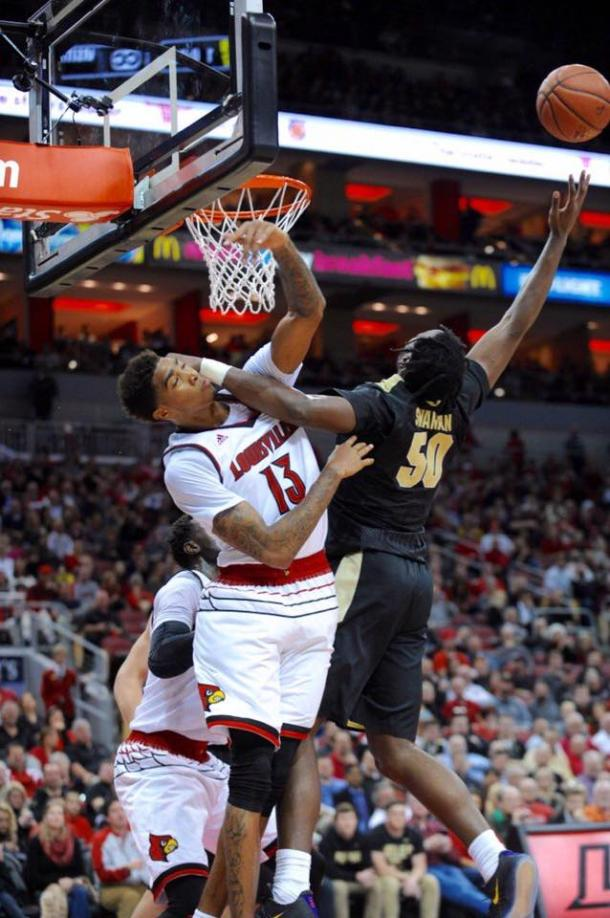 Ray Spalding going for the block against the frustrated Caleb Swanigan who didn't get his first field goal until midway through the second half. | Photo: gocards.com