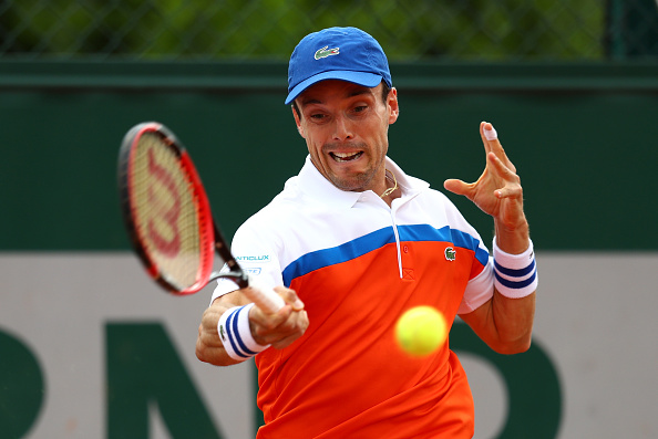 Roberto Bautista Agut rattles off three straight sets in a win over Dmitry Tursunov. | Photo: Julian Finney/Getty Images
