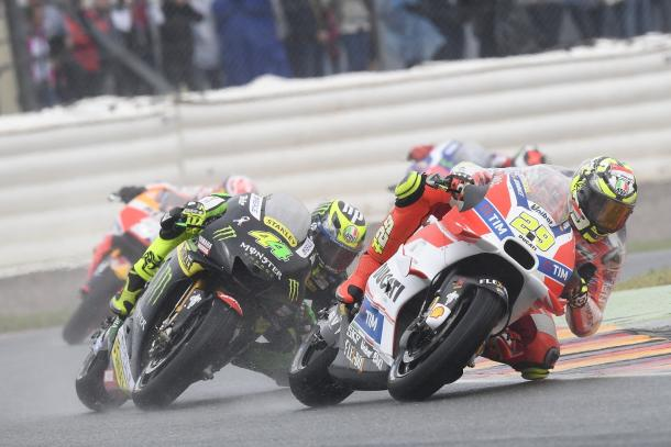 Great action shot in the wet of Iannone and being chased by Bradley Smith - www.ducati.com