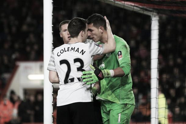 Joel Robles is congratulated by Seamus Coleman and James McCarthy after his penalty save. | Image: Getty Images