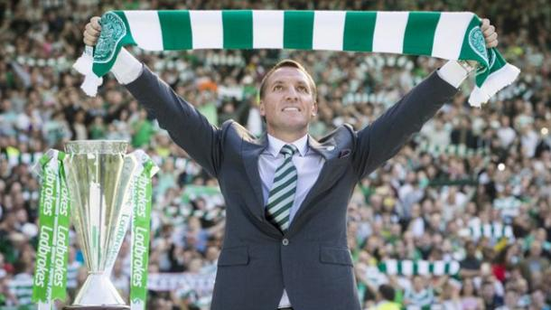 Brendan Rodgers holds scarf aloft in front of 13,000 fans