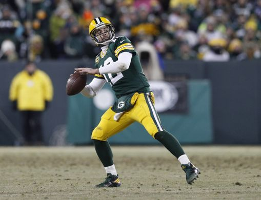 Aaron Rodgers throws Hail Mary to end the first half. | Photo: USA Today Sports
