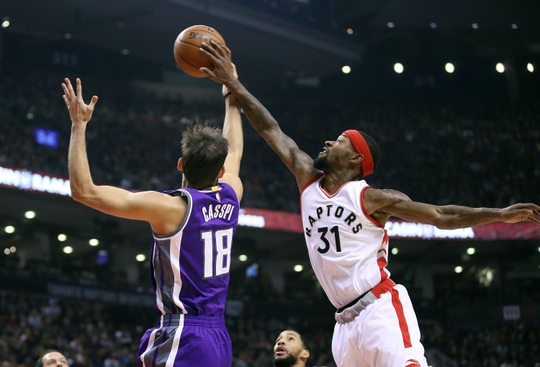 Terrence Ross (right) blocks Omri Casspi (left) PHOTO: Tom Szczerbowski