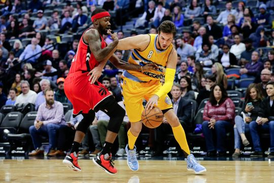 Danilo Gallinari (right) drives on Terrence Ross. PHOTO: Isaiah J. Downing/USA Today Sports