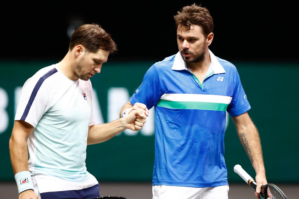 Lajovic (l.) and Wawrinka (r.) during their doubles match/Photo: Pim Waslander/ABN AMRO World Tennis Tournament