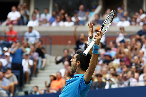 Djokovic celebrates a point in the tiebreak (Photo by Elsa/Getty Images)