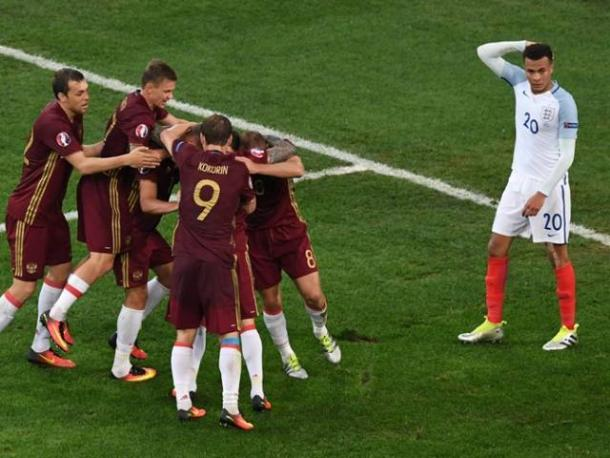 The Russia players celebrate their late equaliser against England | Photo: Getty images