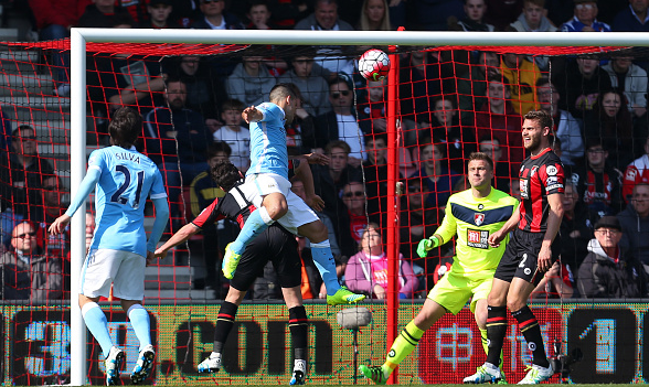 Aguero leaps above his marker to head home, giving City a three-goal cushion in style. | Photo: Getty