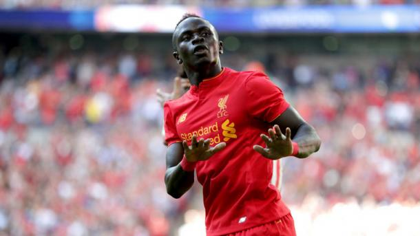 Mane celebrates scoring against Barcelona on Saturday. (Picture: Getty Images)